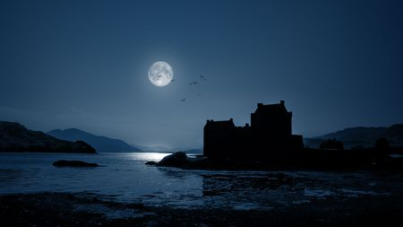 A photography of Eilean Donan Castle by night photo