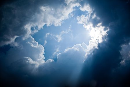 A photography of sun rays and dark clouds Stock Photo - 4885625