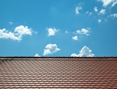 A photography of a roof and a blue sky photo