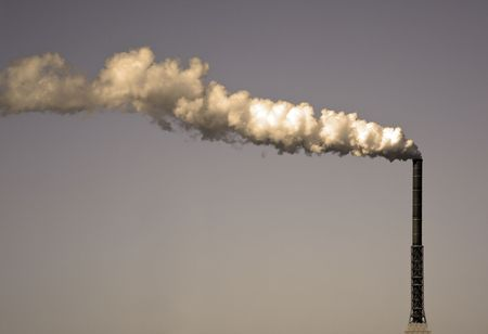 A photography of a dirty smoke stack