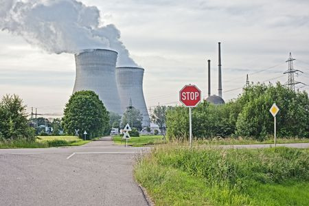 heat radiation: A photography of a nuclear power plant with a stop sign