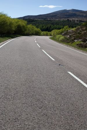 A photography of a road in the scottish highlands photo