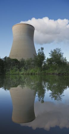 A photography of a cooling tower at the lake Stock Photo - 5512776