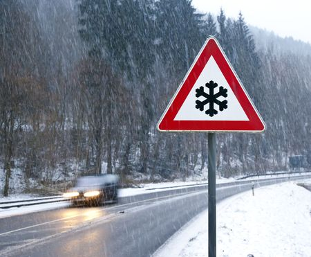 drifting: A photography of a snow street sign