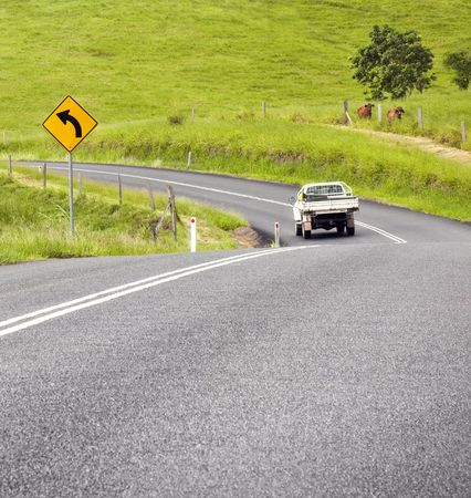 A photography of a road sign curve Stock Photo - 6410328