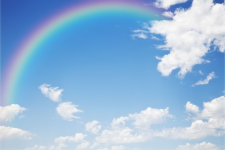 a blue sky rainbow background photo