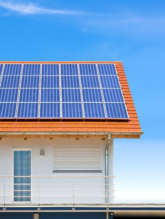 purchasing power: An image of a nice house with solar planels Stock Photo