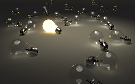 create idea: Some light bulbs only one is glowing. Concept image for having an idea. Stock Photo