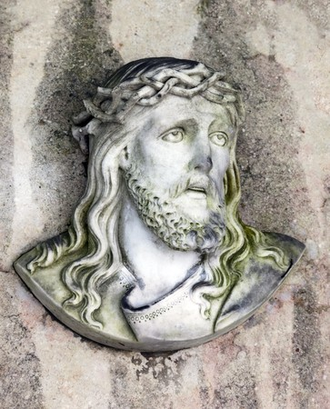 An image of an old jesus statue photo