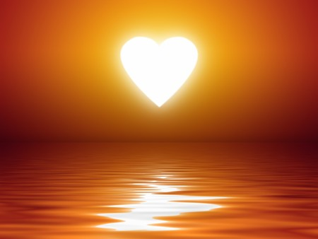 An image of a beautiful sunset heart shape over the ocean