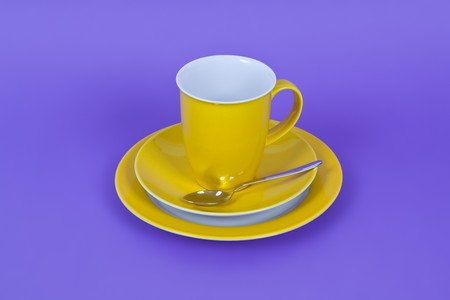 An image of a yellow coffee cup on purple background Stock Photo - 7958389