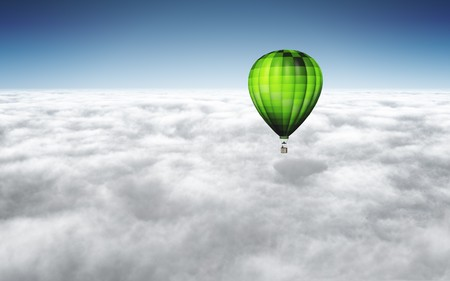 An image of a nice green balloon above the clouds with space for your text photo