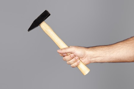 An image of a man holding a hammer photo
