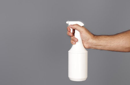 An image of a spray isolated on grey background photo