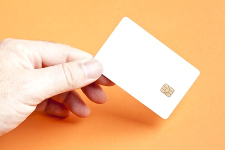 smart card: A man holding a blank smart card Stock Photo