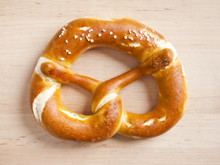 typical german pretzel on a wooden plate photo