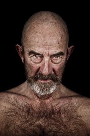 An old man with a grey beard photo