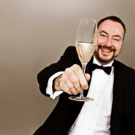 An image of a man with a glass photo
