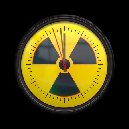 atomic symbol: An image of a radioactive clock three seconds to noon