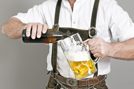 An image of a traditional bavarian man who fills in beer photo