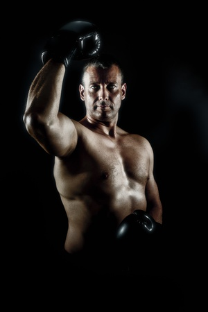 An image of a muscular male in a heroic pose photo