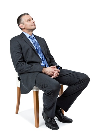 sitting up: A sitting handsome business man is looking up