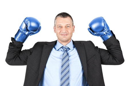blue gloves: An image of a business man boxing