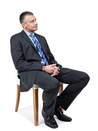 persona sentada: Se busca un hombre de negocios guapo de sesi�n Foto de archivo