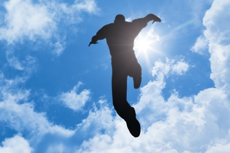 high life: An image of a jumping man in the blue sky