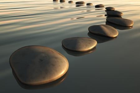 piedras zen: Una imagen de algunas piedras de paso para la puesta de sol