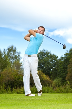 golfing: An image of a young male golf player