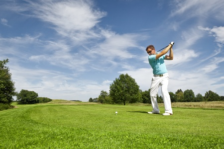 golf swings: An image of a young male golf player