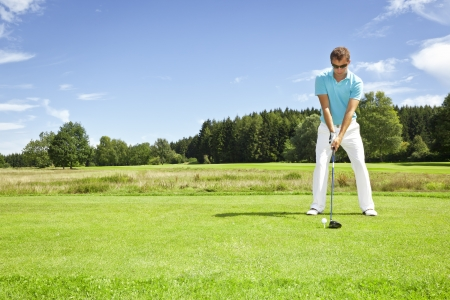 tee off: An image of a young male golf player