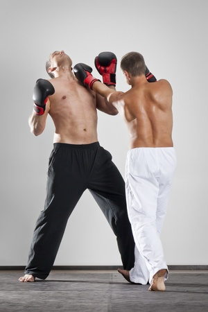 An image of two men box fighting photo
