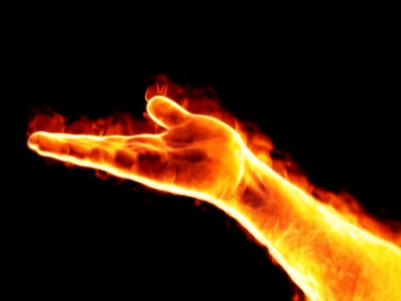 glowing skin: An image of a nice male palm on fire Stock Photo
