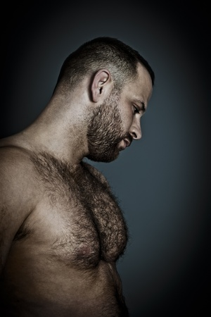 An image of a hairy muscle man photo