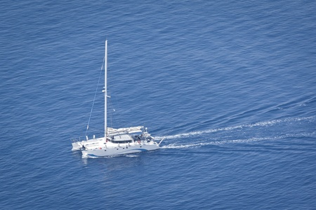 An image of a nice boat in the blue ocean photo