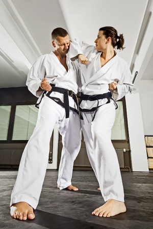 martial arts woman: An image of a women and a man fighting Stock Photo