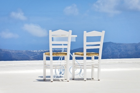 two chairs: An image of two chairs in the sun