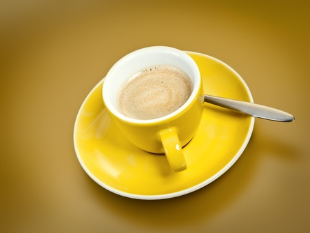 A cup of coffee with on golden background photo