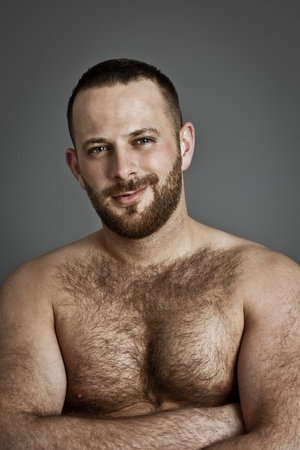 An image of a hairy handsome man with a beard photo