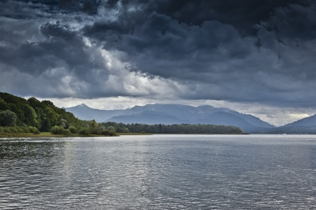 An image of a dramatic sky at the Chiemsee in Germany photo