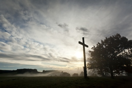 An image of a dramatic sky and a cross photo