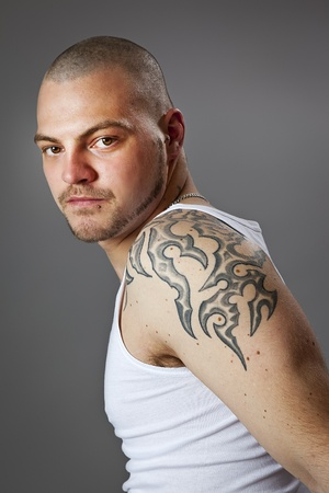 An image of a handsome man with tattoos photo