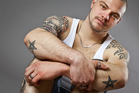 tattoo arm: An image of a handsome man with tattoos