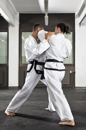 An image of a women and a man fighting photo