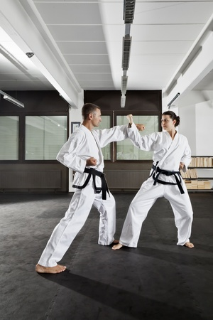 An image of a women and a man fighting Stock Photo