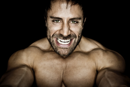 An image of an angry muscular sports man photo