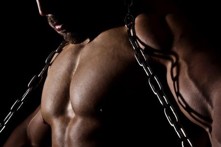 fortaleza: Una imagen de un hombre musculoso deportivo Foto de archivo