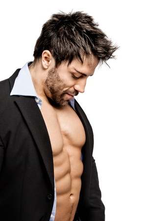 muscle training: Ein gut aussehender junger Mann, muskul�s Sport im Business-Anzug Lizenzfreie Bilder